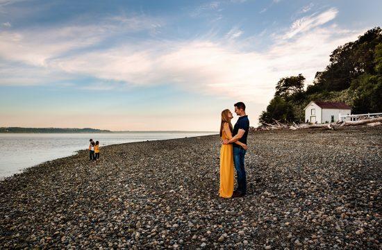 family plays at vashon island beach by the lighthouse, family at sunset on the beach gig harbor, beautiful skies at sunset on vashon island