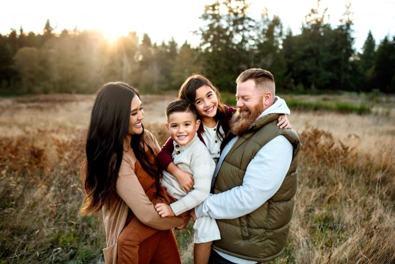 beautiful family hugging and posing for photos in Gig Harbor